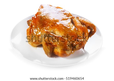 plate of roasted chicken isolated on white background
