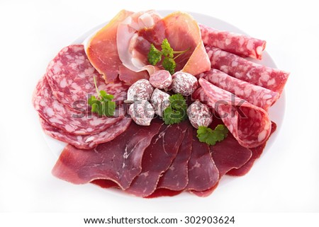 plate of salami,bacon - stock photo