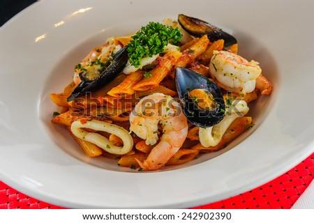 Plate of sea food pasta. - stock photo