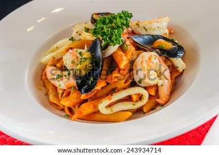 Plate of sea food pasta - stock photo