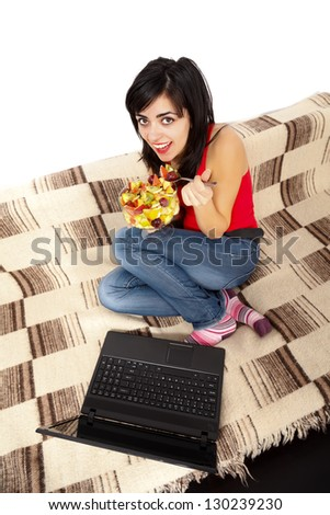 Plate of sliced fruits held by a smiling healthy girl. - stock photo