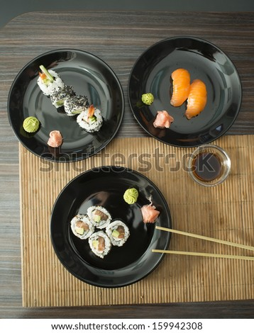 Plate of sushi in restaurant - stock photo