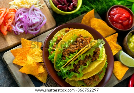 plate of tacos, nachos and tomato dip