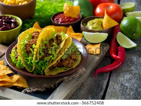plate of tacos, nachos and tomato dip - stock photo
