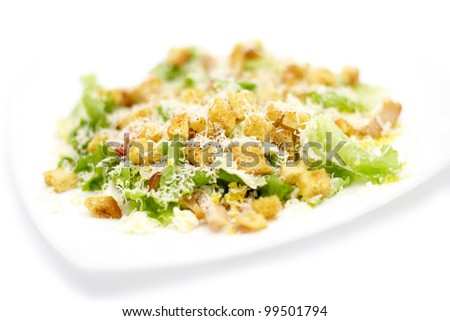 plate of traditional caesar salad with chicken - stock photo