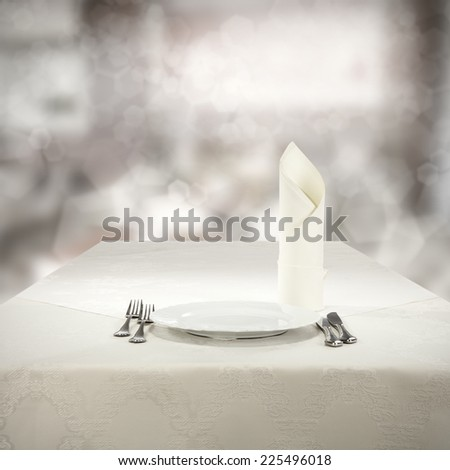 plate of white and white napkin  - stock photo