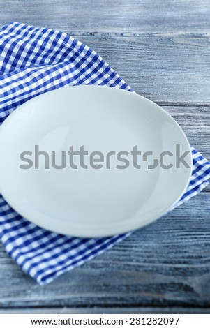 Plate on a checkered napkin, close-up