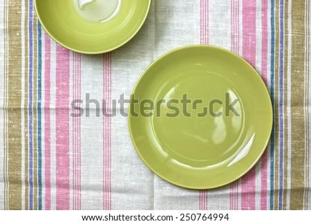 plate on linen napkin - stock photo