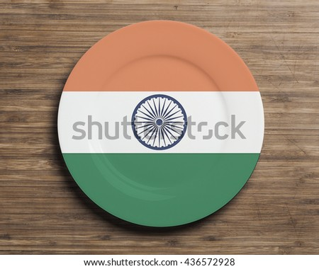 Plate on table with overlay flag of India - stock photo