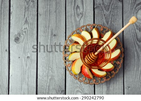 Plate with apple and honey for Jewish Holiday Rosh Hashana. View from above with copy space - stock photo