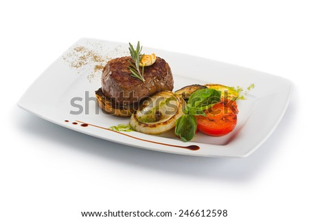 Plate with barbecue grilled beef steak meat with vegetables. Isolated on white.