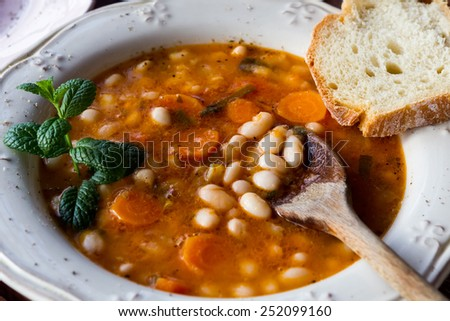 Plate with bean soup.Selective focus - stock photo