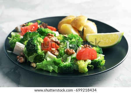 Plate with broccoli salad on table