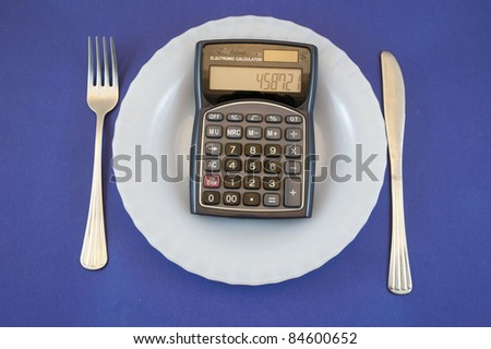 plate with calculator - stock photo
