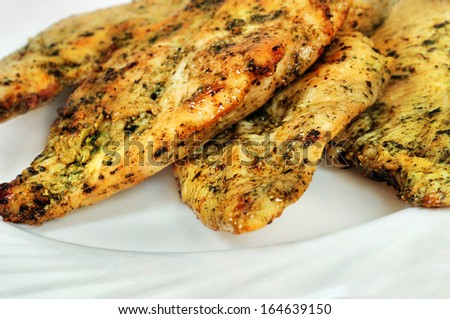 Plate with chicken marinated on background - stock photo