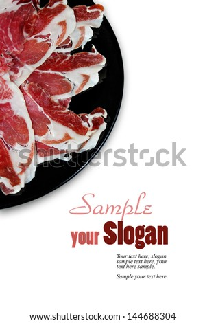 plate with cured ham and example texts - stock photo