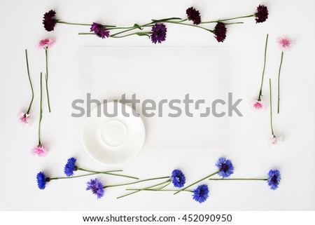 Plate with decoration of flowers on white background. Overhead view. Flat lay. - stock photo