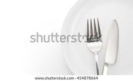 plate with fork and knife on a white background with sample text