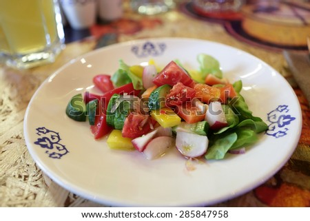 Plate with fresh vegetables salad on a white plate