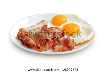 Plate with fried eggs, bacon and chicken sausage on white background - stock photo