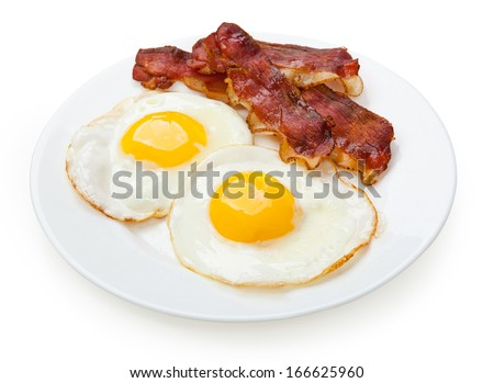 Plate with fried eggs, bacon isolated on white background  - stock photo