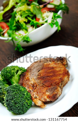 Plate with grilled meat and broccoli