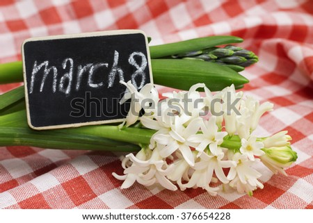 Plate with inscription 'March 8' and hyacinths, close-up