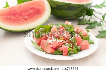 Plate with juicy watermelon salad horizontal - stock photo
