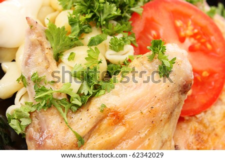 Plate with meal. A hen, macaroni, parsley.