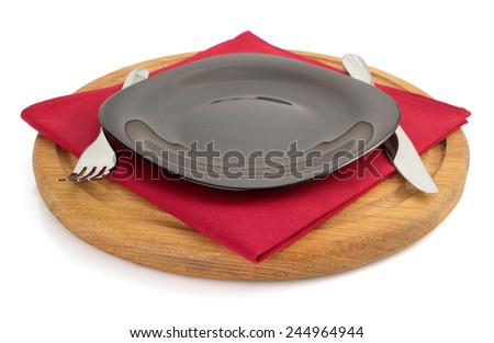 plate with napkin at cutting board  on white background - stock photo
