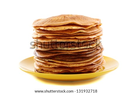 Plate with pancakes on a white background.