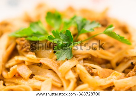 plate with pasta and parsley close up - stock photo