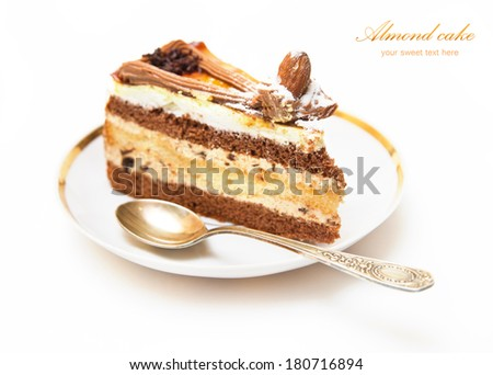 Plate with piece of delicious almond cake and dessert spoon