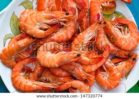 Plate with prawns close-up - stock photo