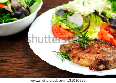Plate with salad and meat