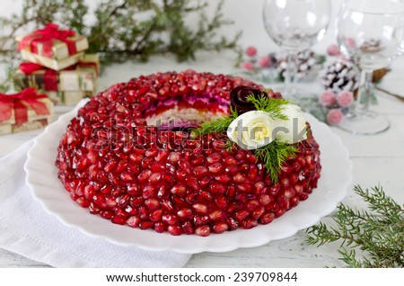 Plate with salad Garnet bracelet on the holiday table - stock photo