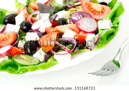 Plate with salad on white