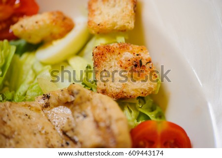 plate with salad with meat on the wooden table. Top view
