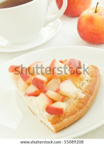 Plate with slice of apple cake and teacup. Shallow dof. - stock photo
