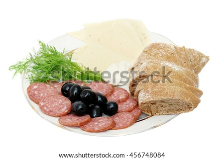 Plate with sliced smoked sausage, bread, cheese, olives, dill and sauce