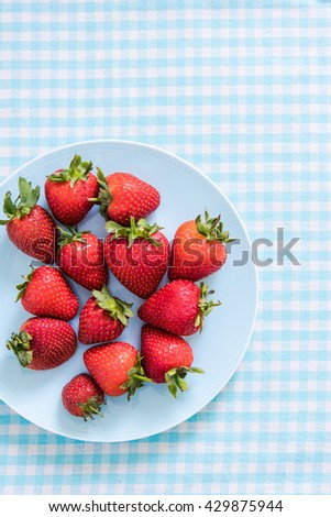 plate with strawberries, overhead view on table