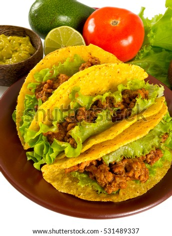 plate with tacos and nachos isolated on white