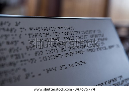 Plate with text for visually impaired people with spot focus effect, close up - stock photo