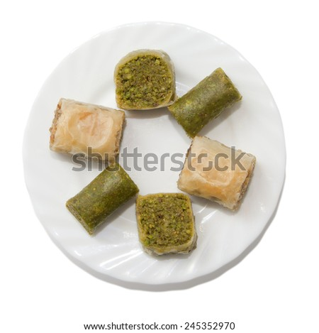 Plate with turkish baklava isolated over white background - stock photo