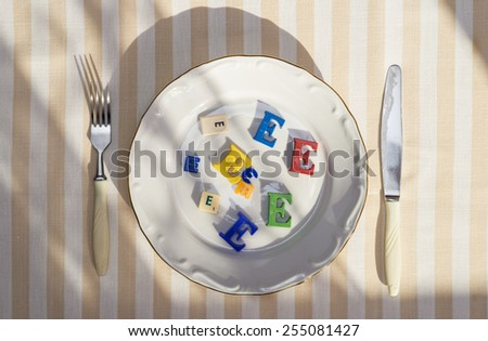 Plate with unhealthy foods with preservatives