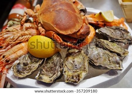Plateau de fruits de mer (seafood platter) in a market in Brittany - stock photo