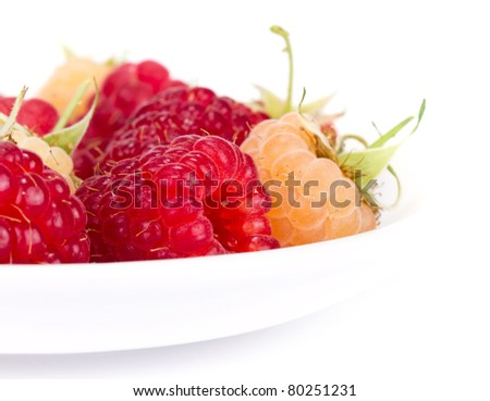 plateful of fresh raspberries on white