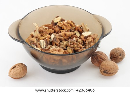 Plateful of walnut. Isolated white.