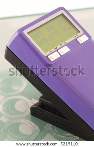 Platereader with measured halftone on the screen and a CTP offset printing plate - stock photo
