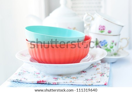 Plates and cups on the kitchen table - stock photo